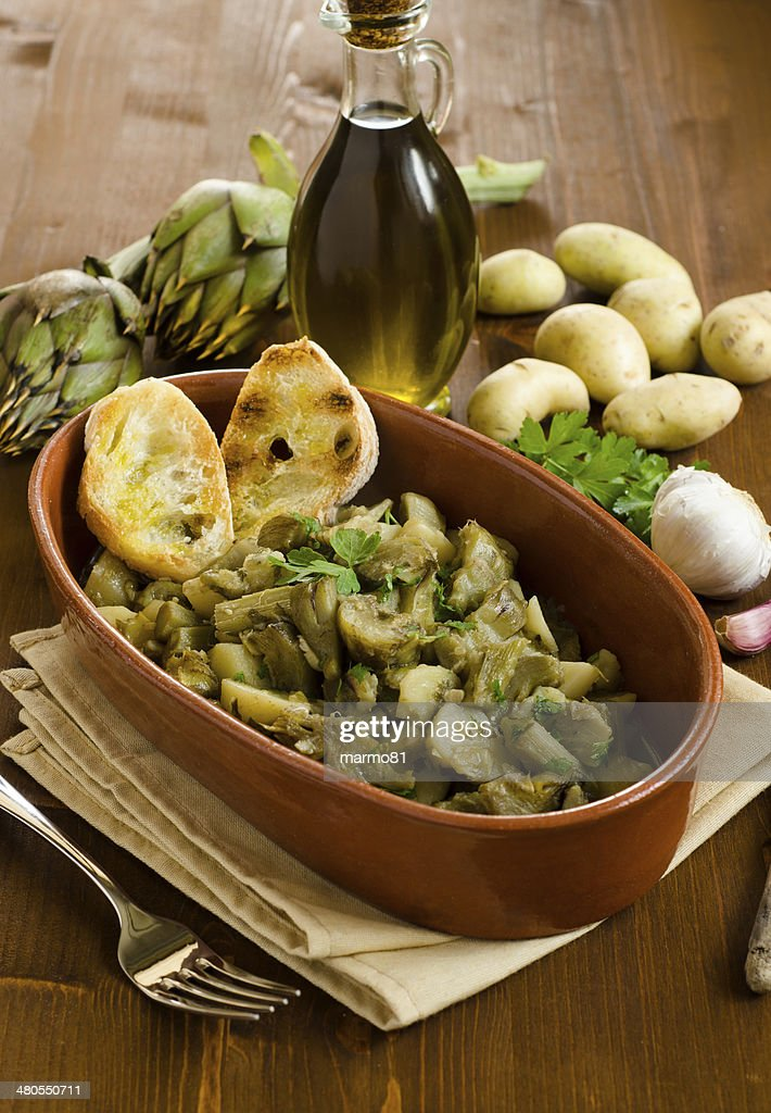 Artichoke and potato stew : Stock Photo