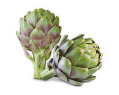 Ripe green artichokes isolated on white background