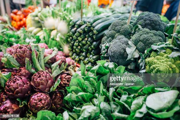 Artichokes, Broccoli and other assorted green vegetables at the farmer's market in Bologna, Italy