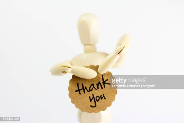 Articulated doll delivers a thank you card