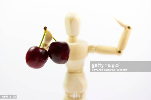 Articulated doll sells cherries
