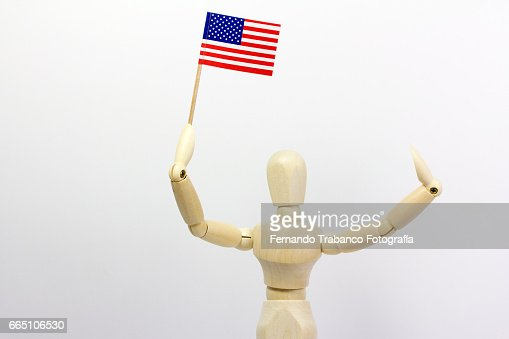 Articulated doll standard bearer with  the United States flag : Stock Photo