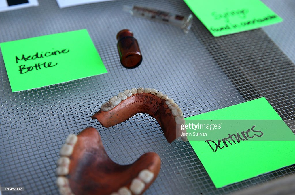 Artifacts are displayed that were excavated from an historic graveyard discovered during construction at Santa Clara Valley Medical Center on June 13, 2013 in San Jose, California. Osteologists and archeologists have excavated the remains of 631 people from a construction site at Santa Clara Valley Medical Center along with a number of artifacts that date back to the late 1800s. The excavated graves are bellieved to have been from between the late 1800s and the 1920s. The potter's field, a graveyard reserved for burial of persons who were indigent, unknown or unclaimed, was uncovered by construction crews in February 2012 while doing grading work for the constructin of a new hospital services Building.