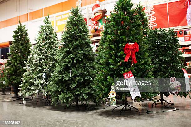 Artificial Christmas trees are displayed inside a Home Depot Inc store in Newark New Jersey US on Saturday Dec 10 2011 Sales at retailers probably...