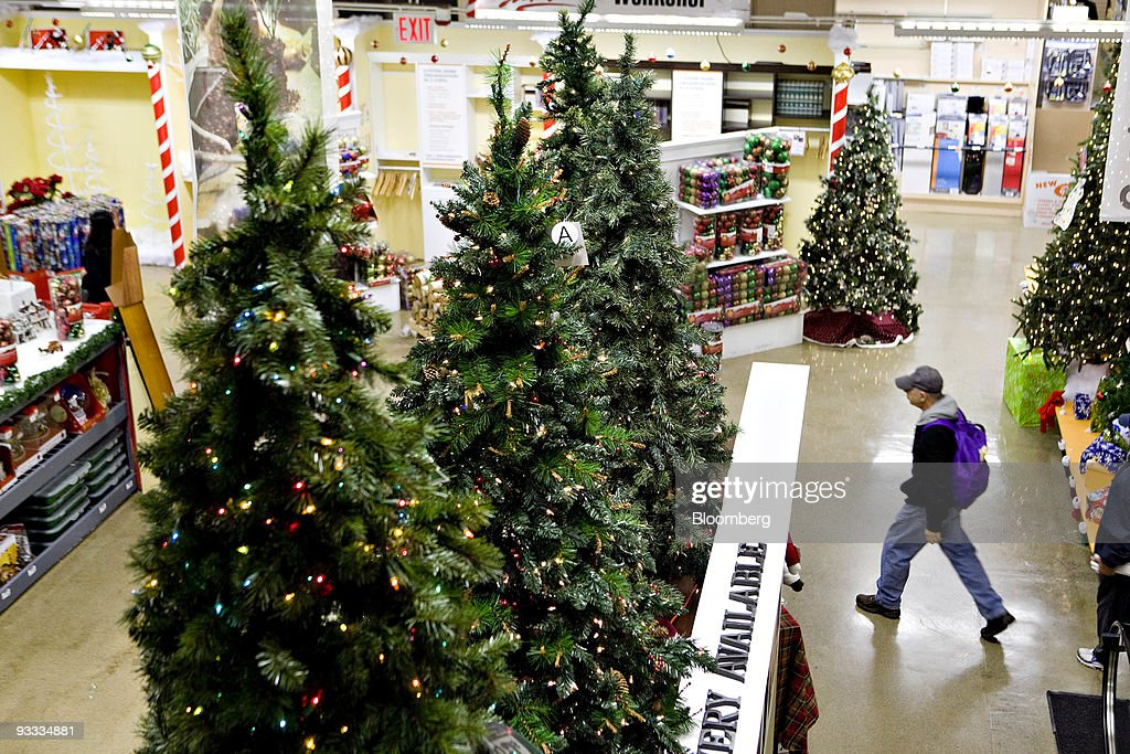 artificial christmas trees sit on display inside a home depot store in new york us