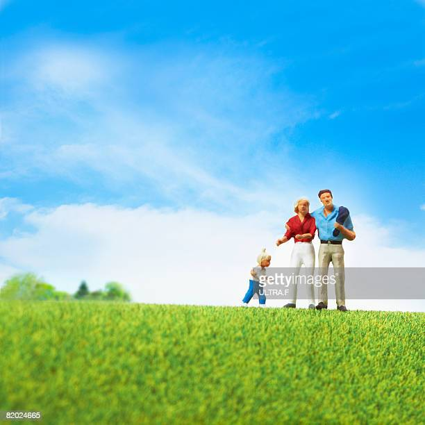 Artificial family standing on the field