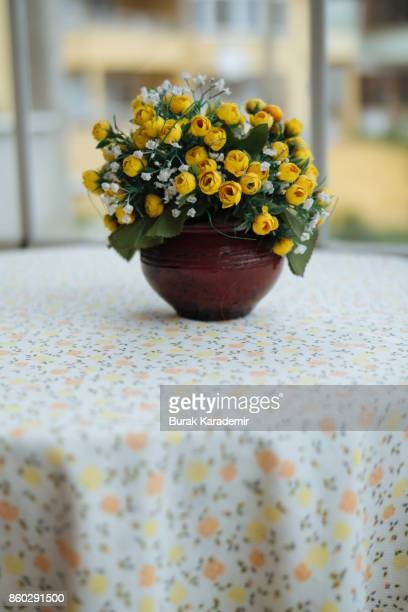 Artificial flower on table