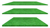 Artificial green grass texture isolated on white background for golf course. soccer field or sports background concept design. grass carpet.