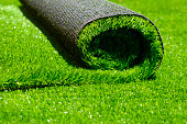 artificial rolled green grass; closeup