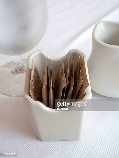 Artificial sweeteners in a holder on a table