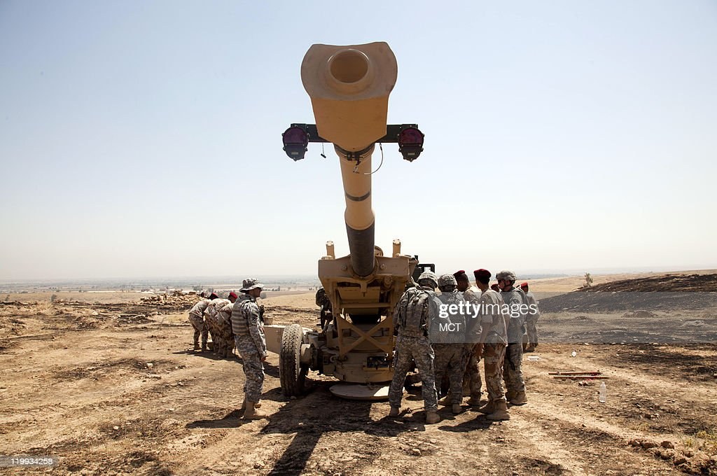 US artillery soldiers train members of the Iraqi Army's artillery unit on how to use a Howitzer As the US military prepares to leave Iraq they...