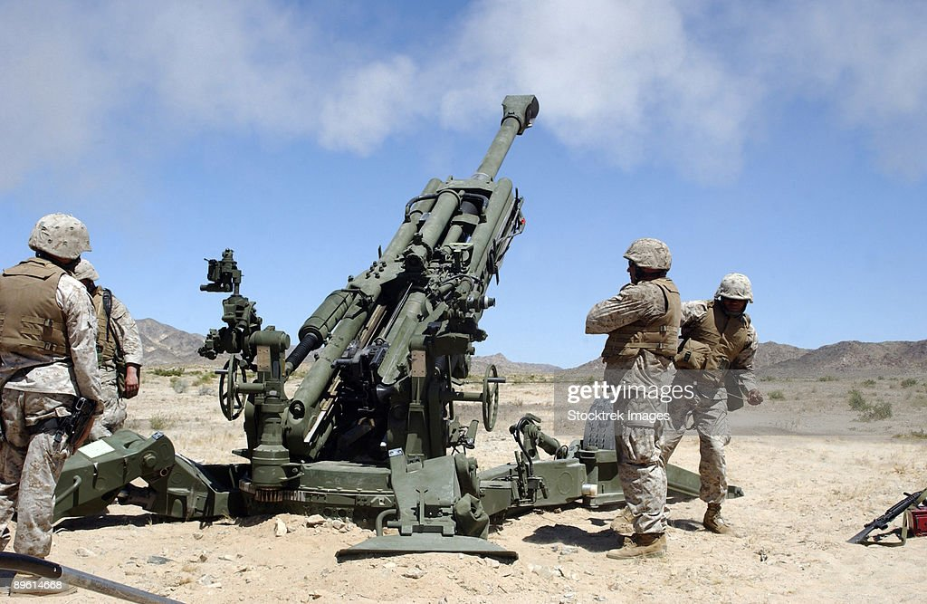 Artillerymen fire-off a round with the newly fielded M777 Lightweight 155-millimeter Howitzer at the Marine Corps Air Ground Combat Center.