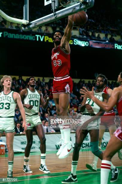 Artis Gilmore of the Chicago Bulls dunks against the Boston Celtics circa 1981 at the Boston Garden in Boston Massachusetts NOTE TO USER User...