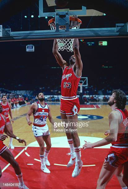 Artis Gilmore of the Chicago Bulls goes up to grab a rebound against the Washington Bullets during an NBA basketball game circa 1981 at the Capital...
