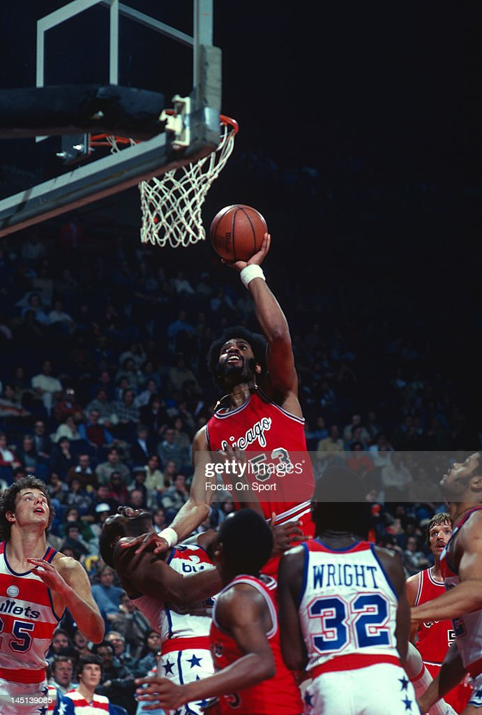 Artis Gilmore of the Chicago Bulls goes up to to shoot over Elvin Hayes of the Washington Bullets during an NBA basketball game circa 1978 at the...