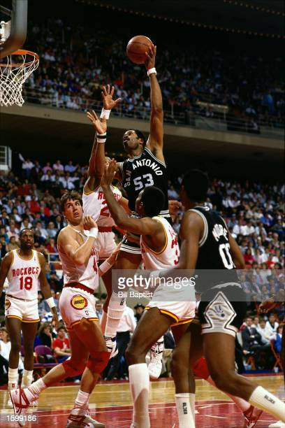 Artis Gilmore of the San Antonio Spurs drives to the basket for a layup against the Houston Rockets during the NBA game in Houston Texas NOTE TO USER...