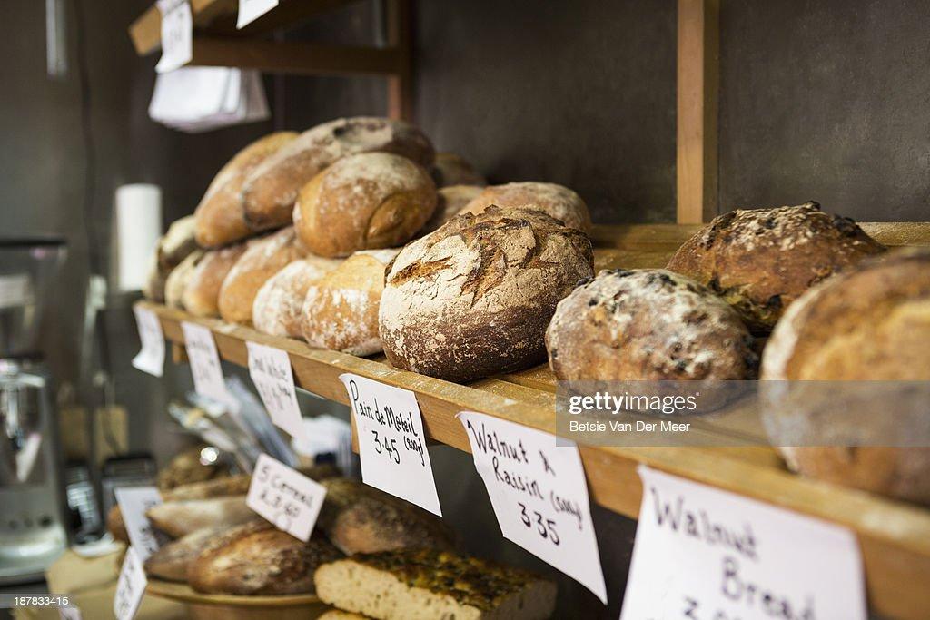 Artisan bread on shelves in bakery. : Stock Photo