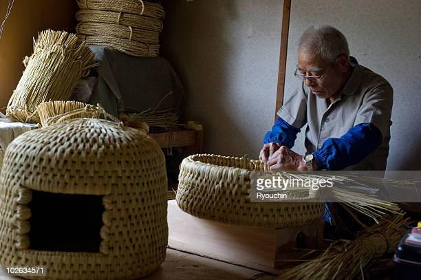 Artisan crafting a Japanese basket