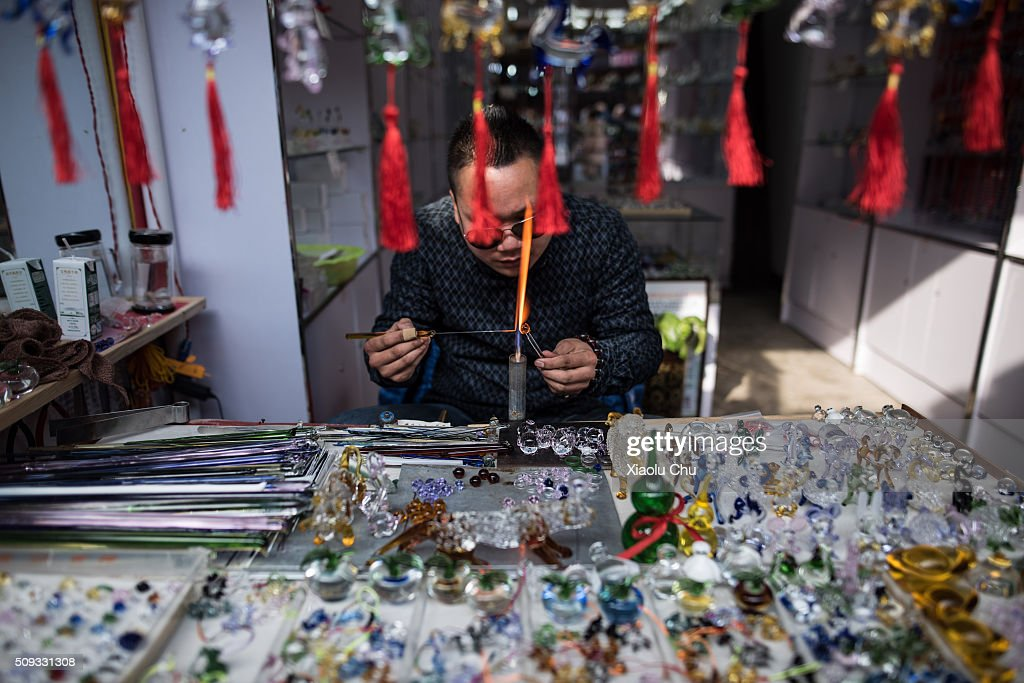 Artisan makes glass toys during Chinese Spring Festival on February 10, 2016 in Hefei, China. The Spring Festival will be celebrated February 7-16 and is the most important holiday in China.