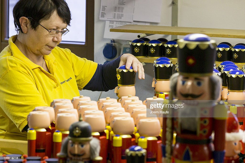 Artisan Martina Beyer at the Seiffener Volkskunst Christmas decorations manufactory assembles a nutcracker on November 20, 2012 in Seiffen, Germany. Located in the Ore Mountains, Seiffen is home to a plethora of workshops that specialize in hand-painted wooden Christmas decorations in a tradition going back centuries.