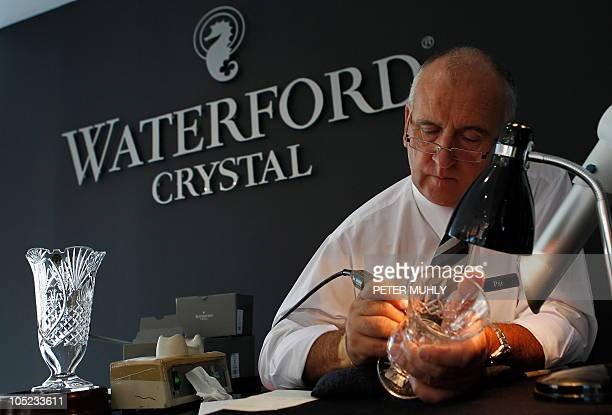 Artisan Pat Boyce engraves a Waterford crystal bowl at the Waterford Crystal plant in Waterford southeast Ireland on October 6 2010 Ireland's...