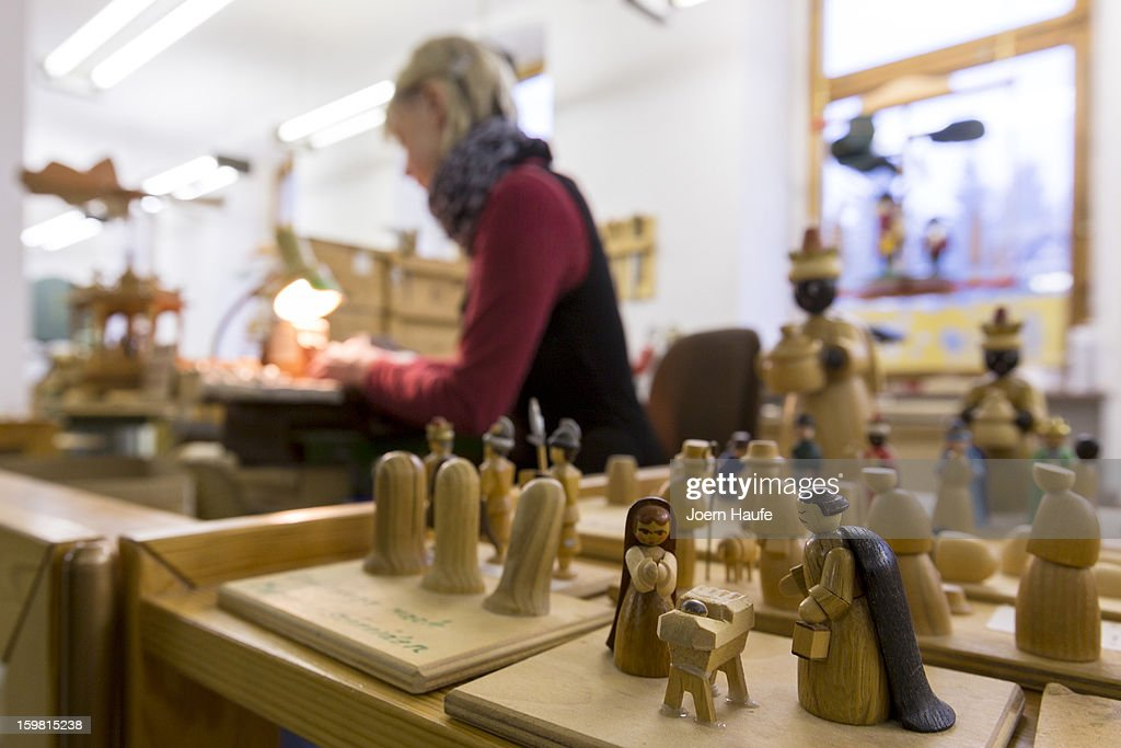 Artisan Rosi Groeschl prepares miniature, wooden parts for Christmas figurines at the Richard Glaesser GmbH wooden toy manufactory on November 20, 2012 in Seiffen, Germany. Located in the Ore Mountains, Seiffen is home to a plethora of workshops that specialize in hand-painted wooden Christmas decorations in a tradition going back centuries.