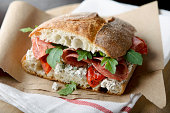 """""""Rustic sandwich of salami, roasted red peppers, arugula, and herbed goat cheese on ciabatta bread.  Very shallow DOF.MORE IMAGES:"""""""