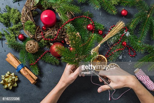 Artisan woman working on handmade Christmas decorations : Stock Photo