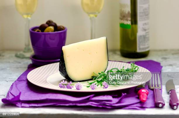 Artisanal goat cheese with lavender flowers, olives and white dry wine