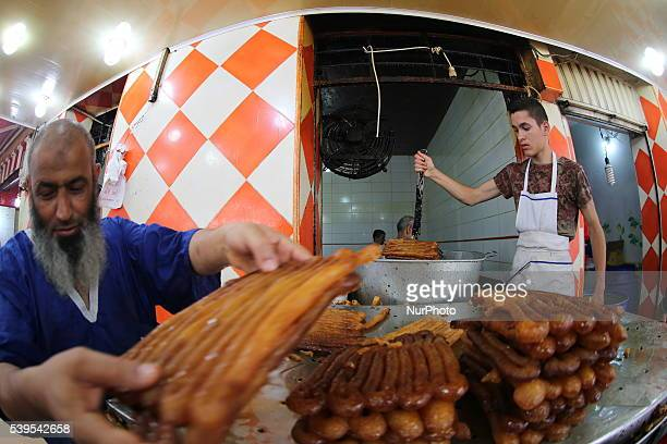 artisanal preparation of zlabia delicacy prized by Algerians during Ramadan Depending on the recipe it contains sugar flour honey cardamom and is...