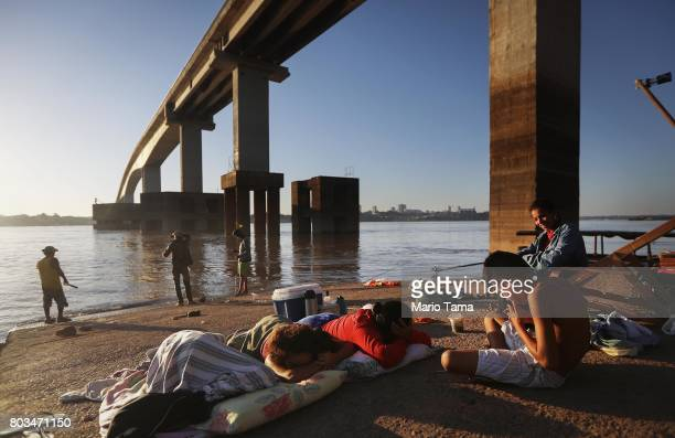 Artisinal fishermen gather beneath the BR319 highway bridge crossing the Madeira River in a deforested section of the Amazon rainforest on June 25...