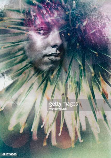 Artisitc image of a woman's face double exposed with foliage