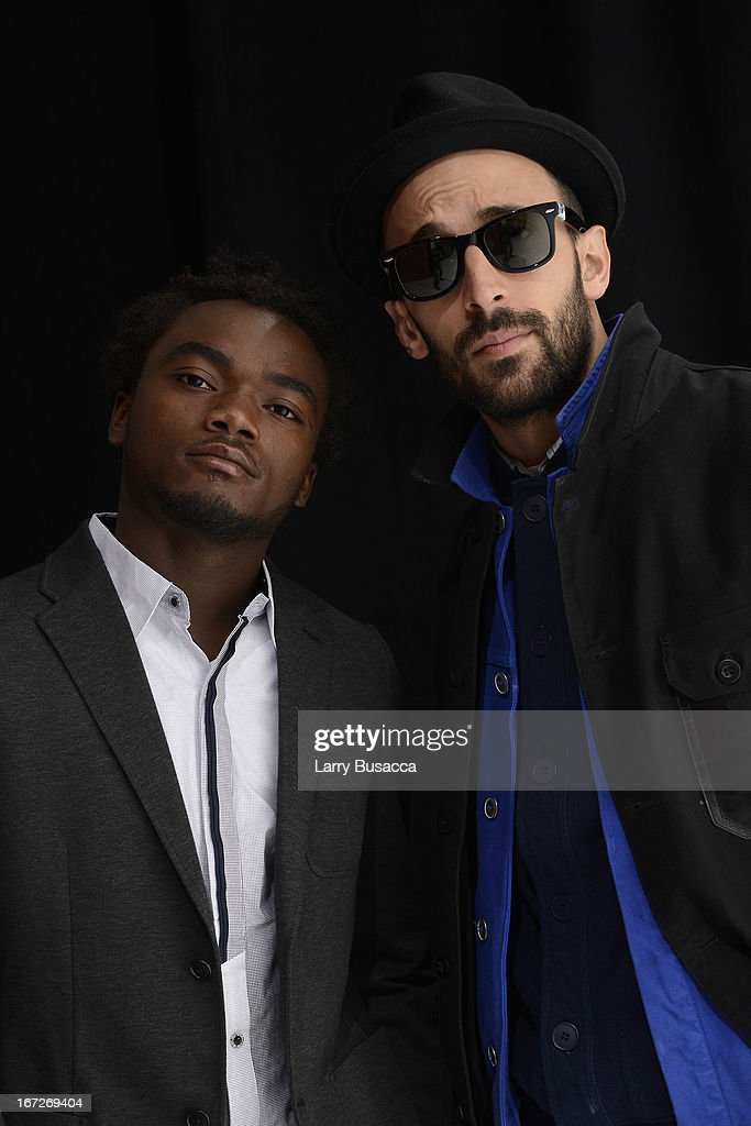 Artisits Romel Jean Pierre and JR of the film 'Inside Out: The People's Art Project' poses at the Tribeca Film Festival 2013 portrait studio on April 23, 2013 in New York City.