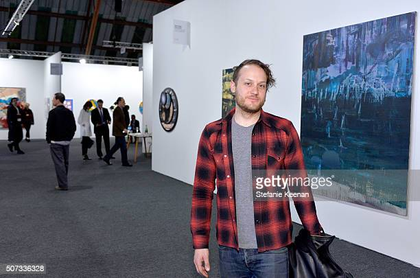 Artist Aaron Sandnes attends the Art Los Angeles Contemporary 2016 Opening Night at Barker Hangar on January 28 2016 in Santa Monica California