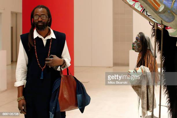 Artist Aboubakar Fofana from Mail looks at masks done by Beau Dick at the opening of the exhibition Documenta 14 at the National Museum of...