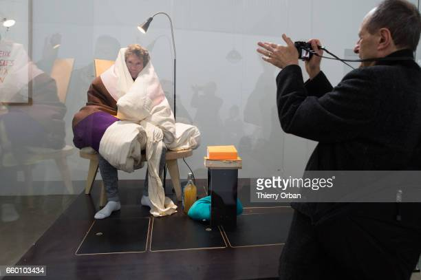 Artist Abraham Pointcheval sits on chicken eggs during his performance of 'Oeuf' during which he will experience gestation by replacing a hen until...