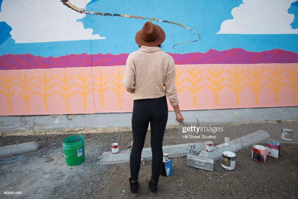 Artist admiring mural wall
