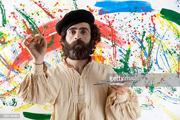 Artist adult man standing before painting
