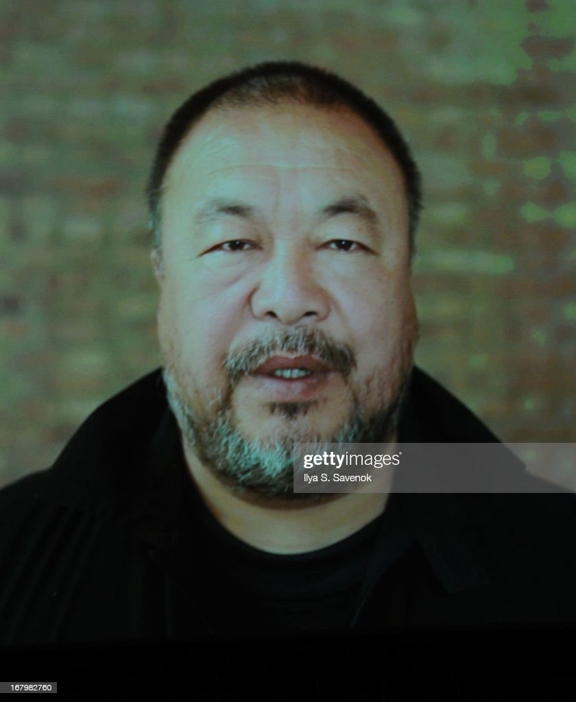 Image was photographed from a projector screen) speaks via Skype during TimeTalks Presents: Freedom and Moral Courage Salman Rushdie and Ai Wei Wei at Times Center on May 3, 2013 in New York City.