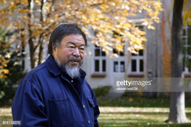 Artist Ai Weiwei is after the press conference on October 26 2015 in the Garden of the University of Arts in Berlin