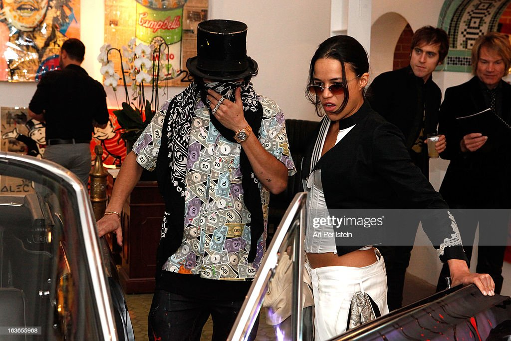 Artist Alec Monopoly and Actress <a gi-track='captionPersonalityLinkClicked' href=/galleries/search?phrase=Michelle+Rodriguez&family=editorial&specificpeople=206182 ng-click='$event.stopPropagation()'>Michelle Rodriguez</a> attend Park Place A Solo Show By Alec Monopoly At LAB ART on March 13, 2013 in Los Angeles, California.