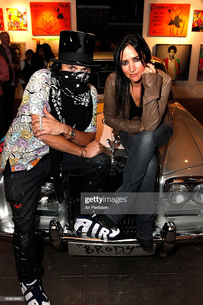 Artist Alec Monopoly and actress Pamela Adlon attend Park Place A Solo Show By Alec Monopoly At LAB ART on March 13, 2013 in Los Angeles, California.