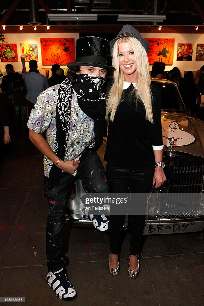 Artist Alec Monopoly and Actress <a gi-track='captionPersonalityLinkClicked' href=/galleries/search?phrase=Tara+Reid&family=editorial&specificpeople=202160 ng-click='$event.stopPropagation()'>Tara Reid</a> attend Park Place A Solo Show By Alec Monopoly At LAB ART on March 13, 2013 in Los Angeles, California.