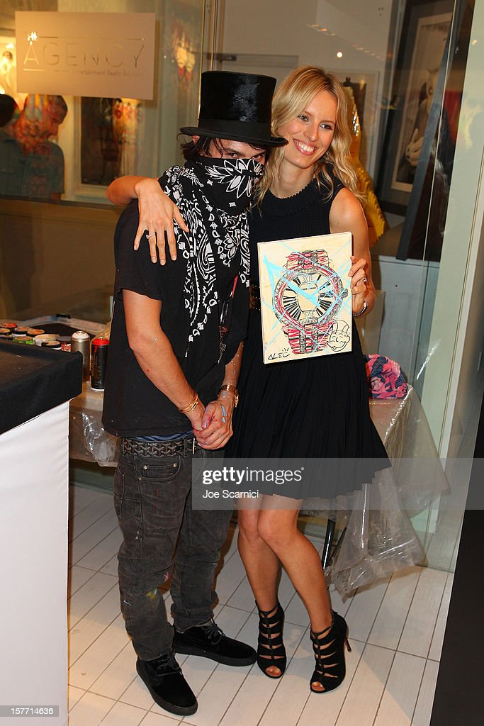 Artist Alec Monopoly and model <a gi-track='captionPersonalityLinkClicked' href=/galleries/search?phrase=Karolina+Kurkova&family=editorial&specificpeople=202513 ng-click='$event.stopPropagation()'>Karolina Kurkova</a> attend the Haute Living and Roger Dubuis dinner hosted by Daphne Guinness at Azur on December 5, 2012 in Miami Beach, Florida.