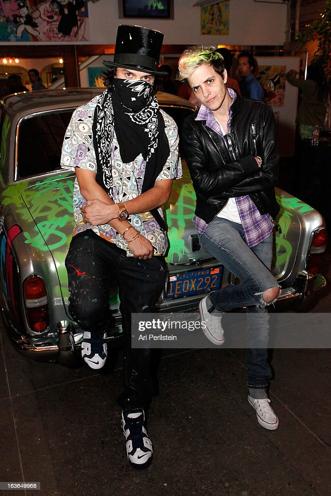 Artist Alec Monopoly and Singer-songwriter Samantha Ronson attend Park Place A Solo Show By Alec Monopoly At LAB ART on March 13, 2013 in Los Angeles, California.