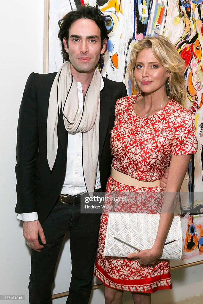 Artist Alexander Yulish (L) and actress <a gi-track='captionPersonalityLinkClicked' href=/galleries/search?phrase=Estella+Warren&family=editorial&specificpeople=214695 ng-click='$event.stopPropagation()'>Estella Warren</a> attend Alexander Yulish 'An Unquiet Mind' VIP Opening Reception at KM Fine Arts LA Studio on March 8, 2014 in Los Angeles, California.