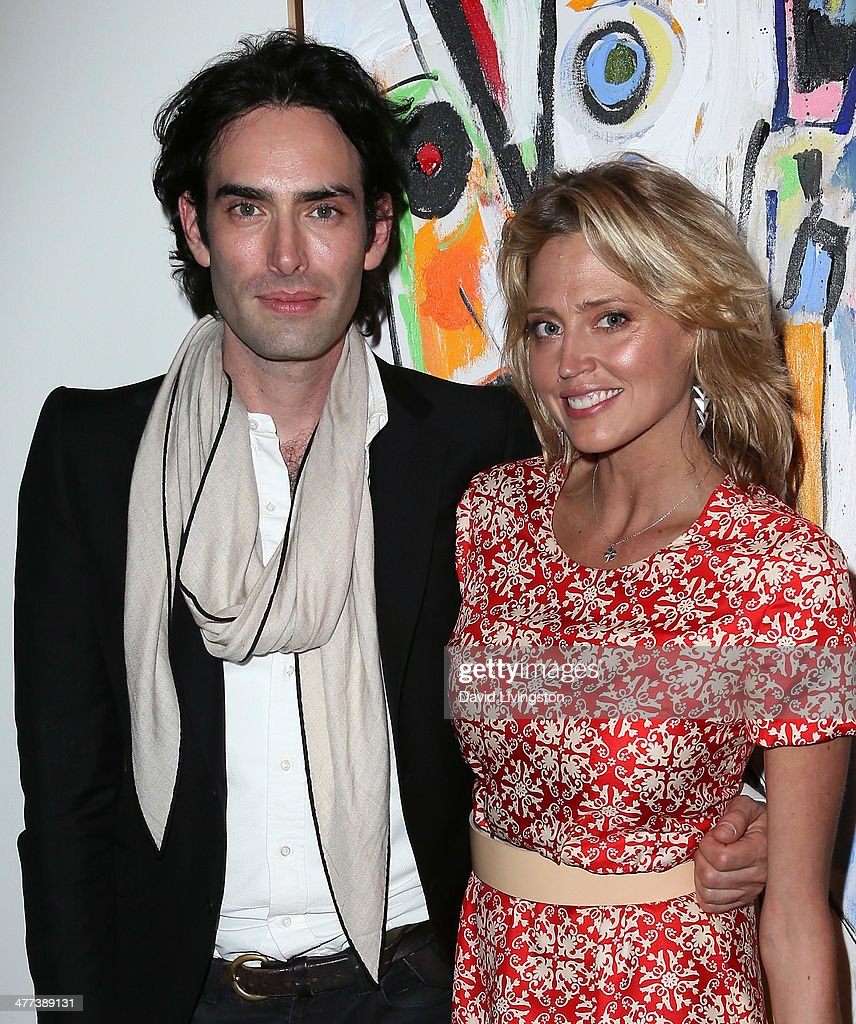 Artist Alexander Yulish (L) and actress Estella Warren attend the Alexander Yulish 'An Unquiet Mind' VIP opening reception at KM Fine Arts LA Studio on March 8, 2014 in Los Angeles, California.