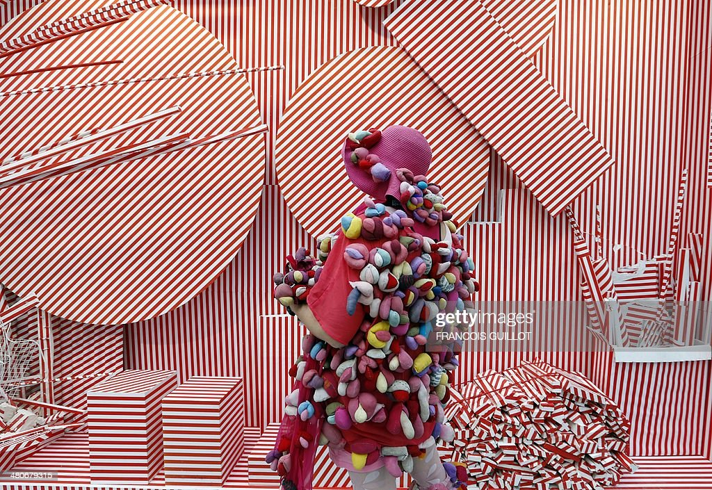 Artist Alexandra Holownia known as 'Alexandra Fly' looks at an art installation by Manuel Merida entitled 'Usuyuki/chantier II', during the 'Art Paris Art Fair', in Paris, on March 26, 2014.