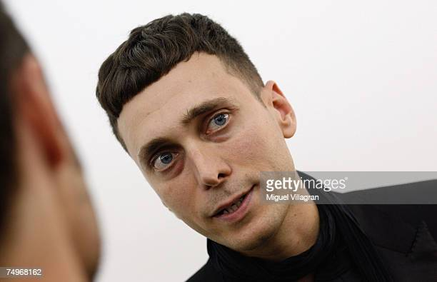 Artist and fashion designer Hedi Slimane talks to the media during a group show curated by him at gallery Arndt Partner on June 30 2007 in Berlin...