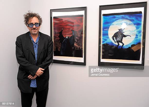 Artist and film maker Tim Burton poses with some of his work at the Tim Burton media preview at The Museum of Modern Art on November 17 2009 in New...